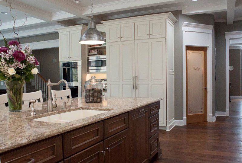 Kitchen With Light Colour Cabinets and Island