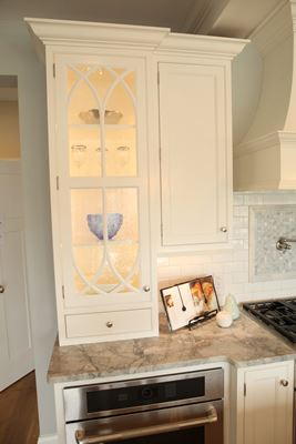 light colored cabinets near stove