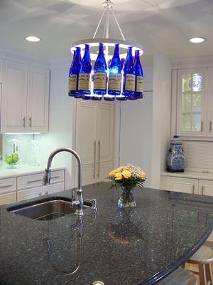 kitchen with bottle lamp and dark counter top