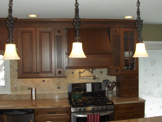 dark kitchen cabinets with hanging lights