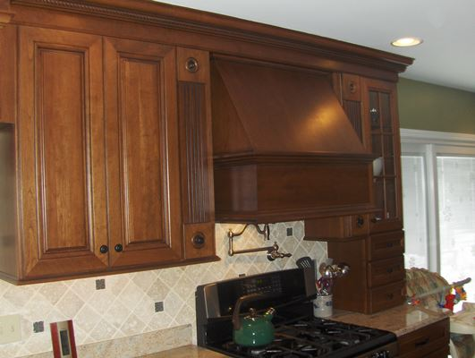 dark wood kitchen cabinets and range hood