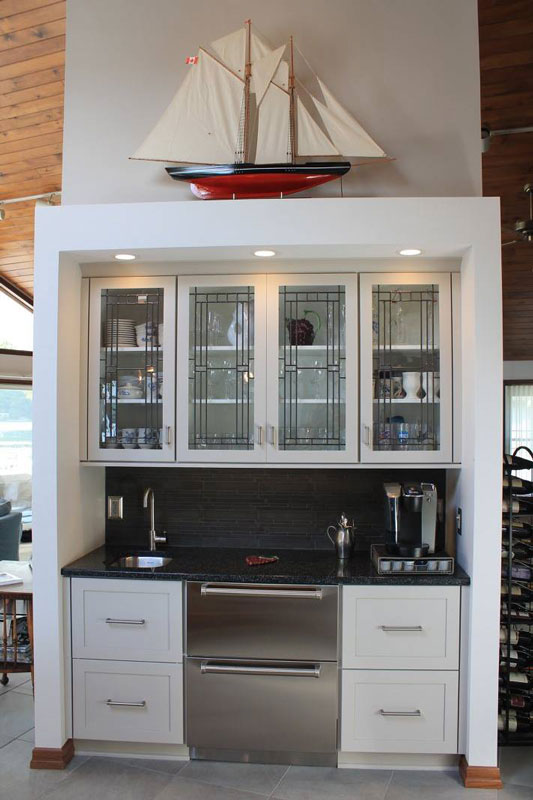 White Cabinetry With Model Boat Displayed